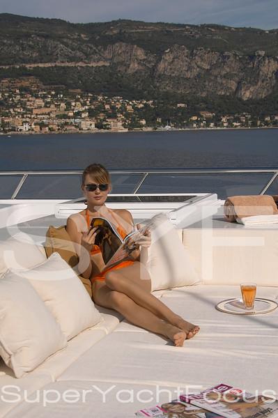 Girl reading magazine on superyacht