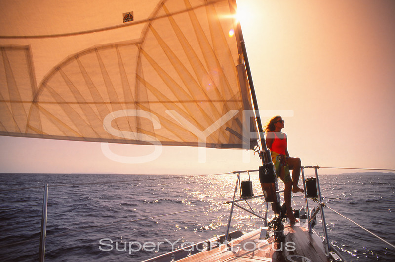 Girl on the bow of sailing yacht