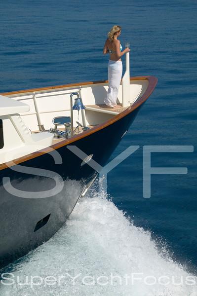 Girl on bow of motoryacht