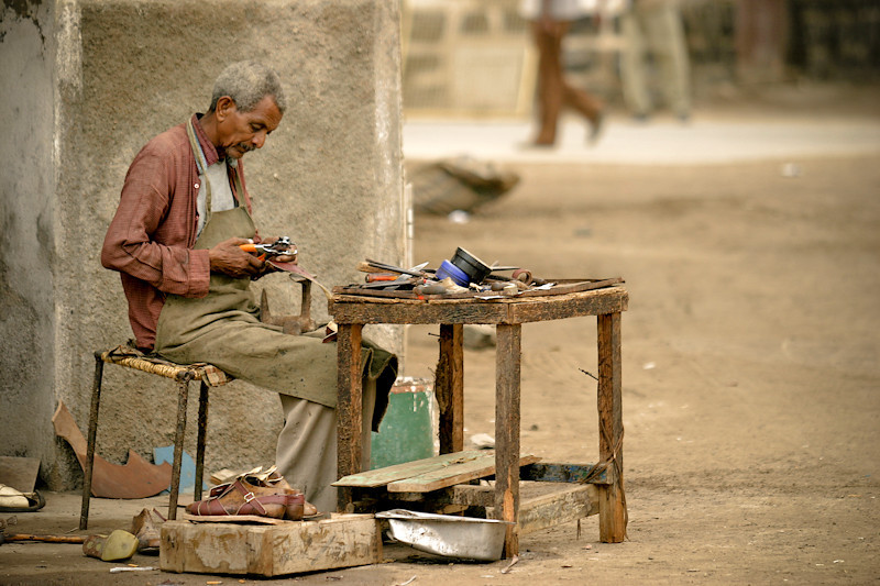 A cobbler at work in the port town of Massawa, Eritrea, a country still recovering from decades of civil war.
