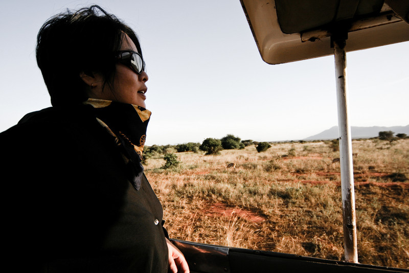 A GET English Student participating in an English Safari program looks out onto a grazing gazelle in Tsavo National Park, Kenya.