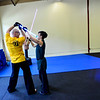 KRISTOPHER RADDER - BRATTLEBORO REFORMER<br /> Biz Hallett, the dean of Brattleboro's school of Ludosport, shows U.S. Army Capt. Jody Holeton, from Fort Gordon, Ga., various ways to block a strike during a training course at Sangha Martial Arts, at 74 Cotton Mill Hill, in Brattleboro, on Friday, May 18, 2018.