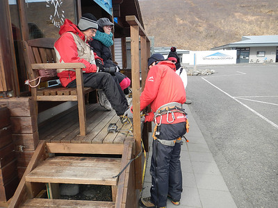 Mark Gromko Being Fitted for Ice Cleats - Svinaefelsjokull Glacier, Iceland - Michael Kirkland - March 2014