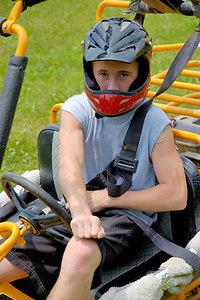 Stock image of teenage boy driving a GoCart