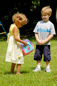 Stock image of young boy and girl playing in the yard together