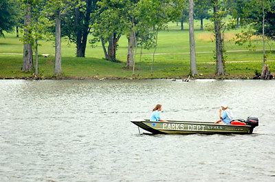 Stock image of a motorboat in the lake at the park