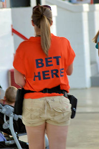 Stock image of a mobile betting cashier at the annual quarter horse races at the Red Mile track in Lexington, Kentucky, USA