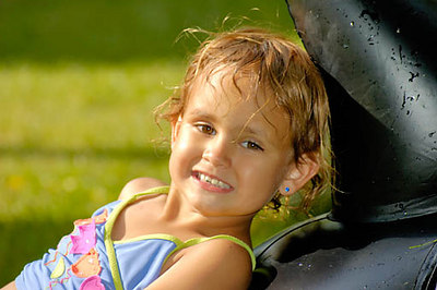 Stock image of a very young brown eyed girl posing with a smile