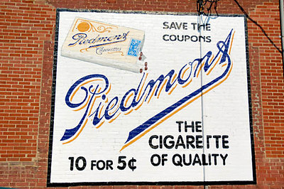 Stock image of the reproduction of an old cigarette ad painted on the side of a brick building