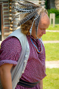 Stock image of native American Indian reenactor with feathered headdress at Fort Boonesborough, Kentucky, USA
