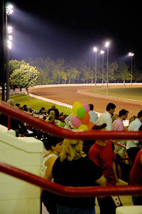 Stock image of a night view of one of the track turns at the annual quarter horse races held at the Red Mile track in Lexington, Kentucky, USA