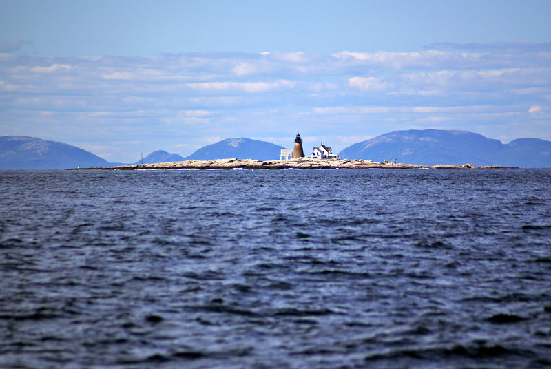 Looking back at Mount Desert Rock Light with Mount Desert Island in the background.