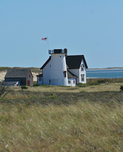 Stage Harbor Lighthouse can be viewed from a mile trail through the sand dunes at Harding Beach, Chatham, MA