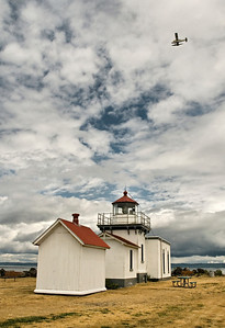 Point No Point lighthouse with seaplane