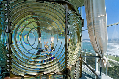 Fresnel lens at the Cape Blanco lighthouse on the Pacific Coast of southern Oregon.  The Cape Blanco Lighthouse started operation on December 20, 1870 with an oil lamp and a class one Fresnel lens.  In 1936 electricity was brought to the lighthouse and in 1980 the lighthouse was automated.  It is still a functioning lighthouse today acting as a navigation aid a warning shipping of the reefs in this area of the Oregon coast.
