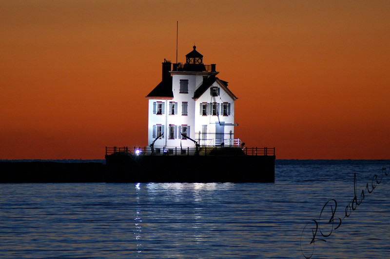 Photo By Robert Bodnar................................Lorain Lighthouse at Night