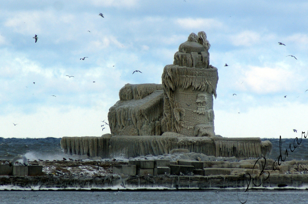 Photo By Bob Bodnar..........Cleveland Harbor Lighthouse after a Wind & Cold Storm on December 13 & 14 of 2010.  Looks like a Giant Sand Castle.