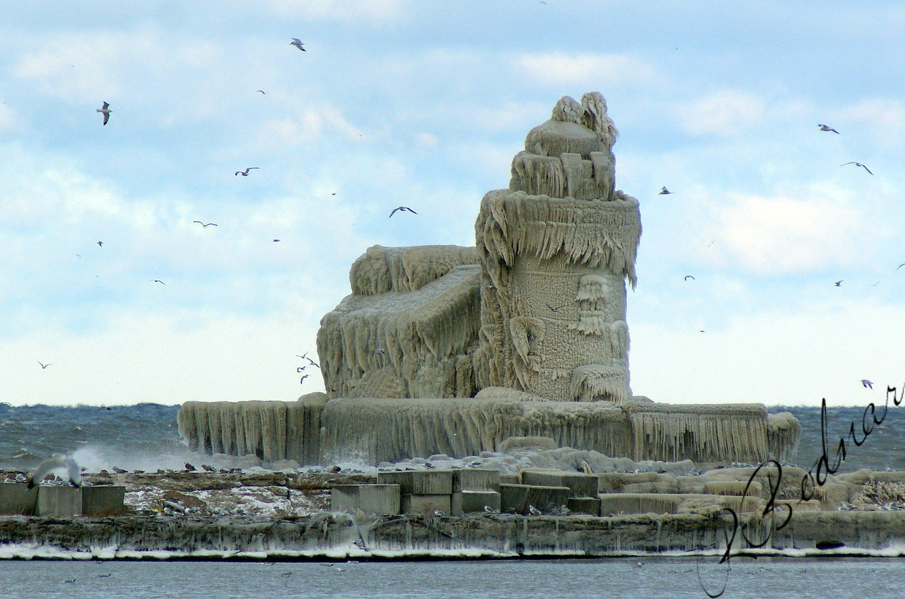 Photo By Bob Bodnar............Cleveland Harbor Lighthouse Covered in Ice,  December 2010