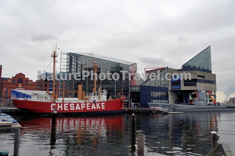 Lightship Chesapeake, Baltimore, MD. Background: National Aquarium in Baltimore, Submarine Torsk and Inner Harbor.