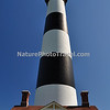 The current Bodie Island Lighthouse is the third that has stood in this vicinity of Bodie Island on the Outer Banks in North Carolina and was built in 1872. It stands 156 feet tall and is located on the Roanoke Sound side of the first island that is part of the Cape Hatteras National Seashore. The lighthouse is just south of Nags Head, a few miles before Oregon Inlet.<br /> <br /> BODIE ISLAND LIGHT FACTS:<br /> <br /> 1847 - The contractor on the first project was Mr. Francis Gibbons, of Baltimore, who would later become a prominent lighthouse builder on the West Coast. Cost was $5,000 but problems with location and design of the tower caused a ten year delay in construction. The tower was highly unstable and soon after it was completed, it began to lean toward the sea.<br /> 1859 - The Bodie Island Lighthouse had deteriorated and the Lighthouse Board secured a $25,000 appropriation from Congress to erect a new tower. This new tower was 80 ft (24 m). and its lantern was a third-order Fresnel lens.<br /> 1861 - In the fall of 1861, Confederate troops stacked explosives inside the tower and blew it apart.<br /> 1871 - A third lighthouse was completed in 1871 partially with material left over from construction of a new tower at Cape Hatteras. The tower was 156 ft (48 m). with a first order Fresnel lens that made its light visible for 18 nautical miles (33 km). The Bodie tower is painted with white and black horizontal bands