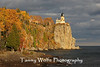 Split Rock Lighthouse with fall foliage and stormy clouds