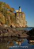 Split Rock Lighthouse with fall foliage and reflection