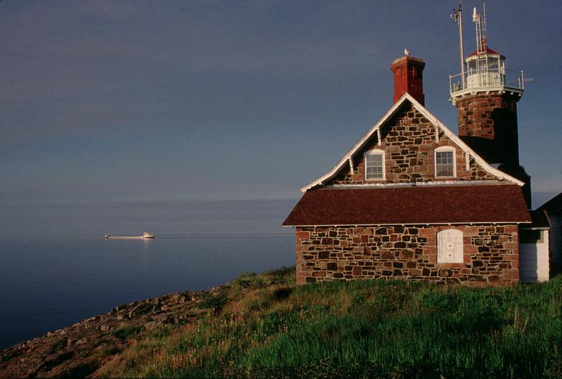 Freighter paassing Passage Island Lighthouse II