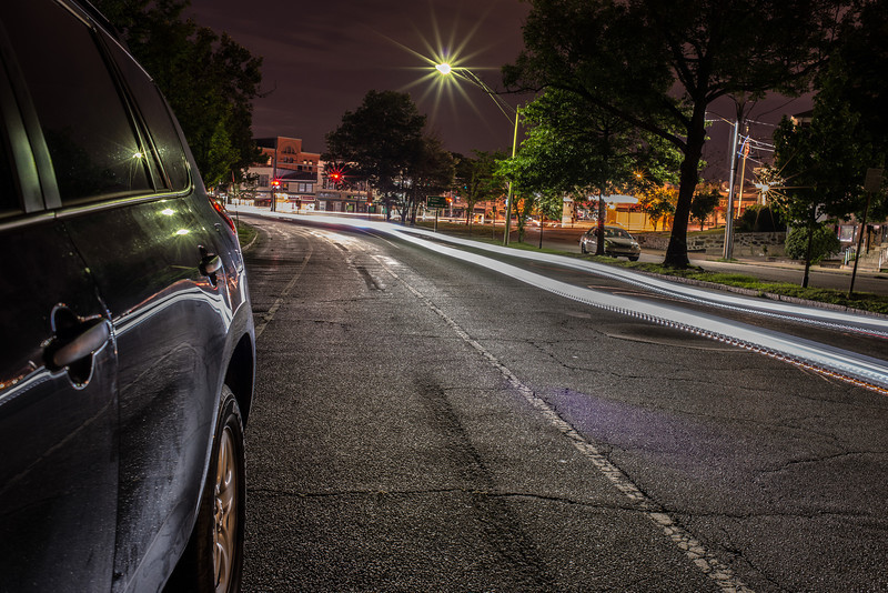 Long exposure on Charles River Road at night in Watertown Square.