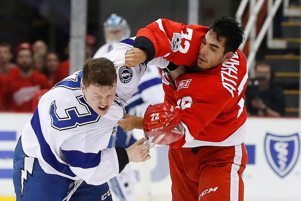 . Detroit Red Wings center Andreas Athanasiou (72) fights with Tampa Bay Lightning left wing Adam Erne (73) in the first period of an NHL hockey game Friday, March 24, 2017, in Detroit. (AP Photo/Paul Sancya)