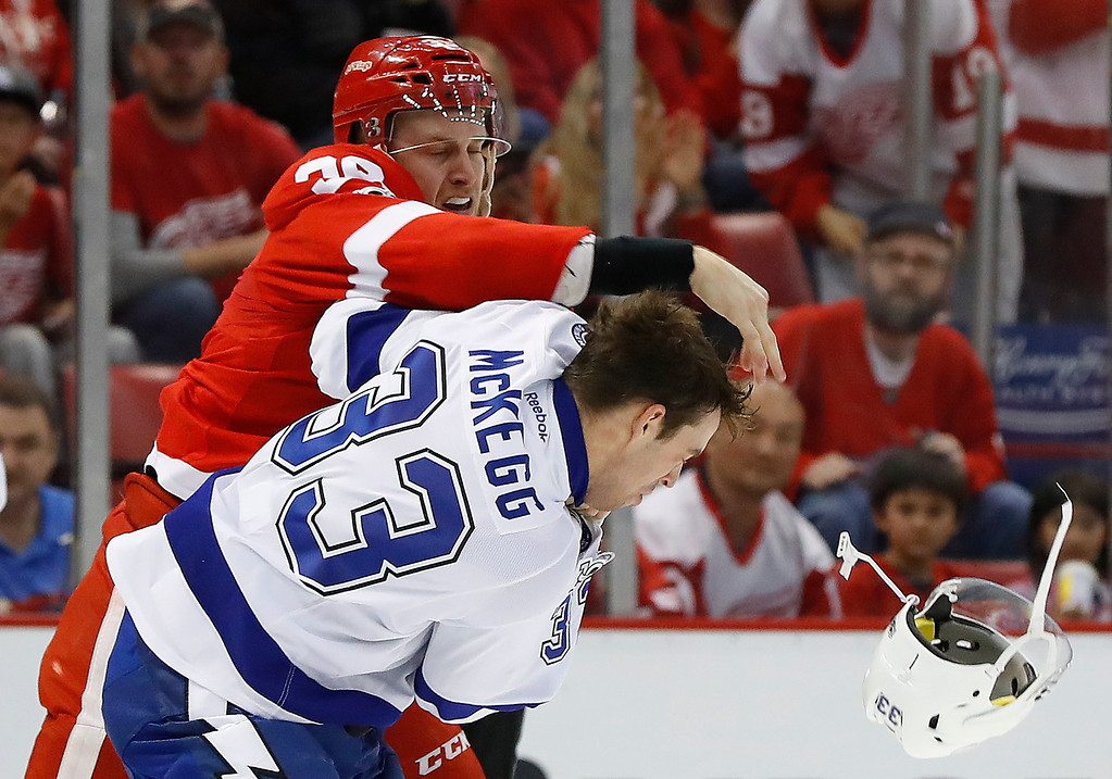 . Detroit Red Wings right wing Anthony Mantha (39) fights Tampa Bay Lightning center Greg McKegg (33) in the second period of an NHL hockey game Friday, March 24, 2017, in Detroit. (AP Photo/Paul Sancya)