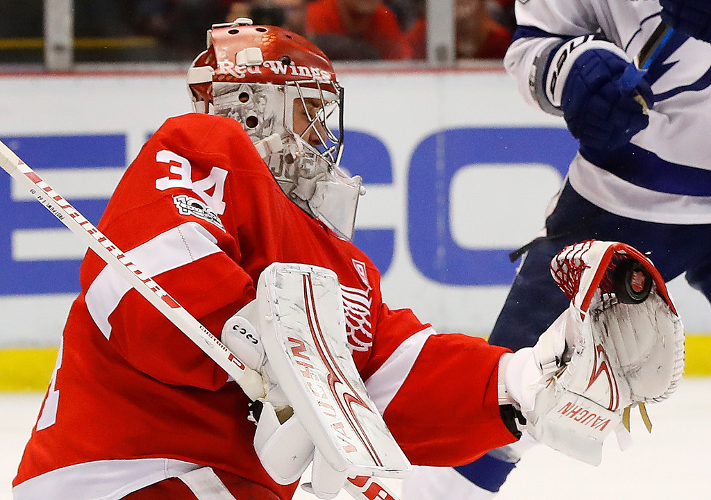 . Detroit Red Wings goalie Petr Mrazek (34) stops a Tampa Bay Lightning shot in the third period of an NHL hockey game Friday, March 24, 2017, in Detroit. (AP Photo/Paul Sancya)
