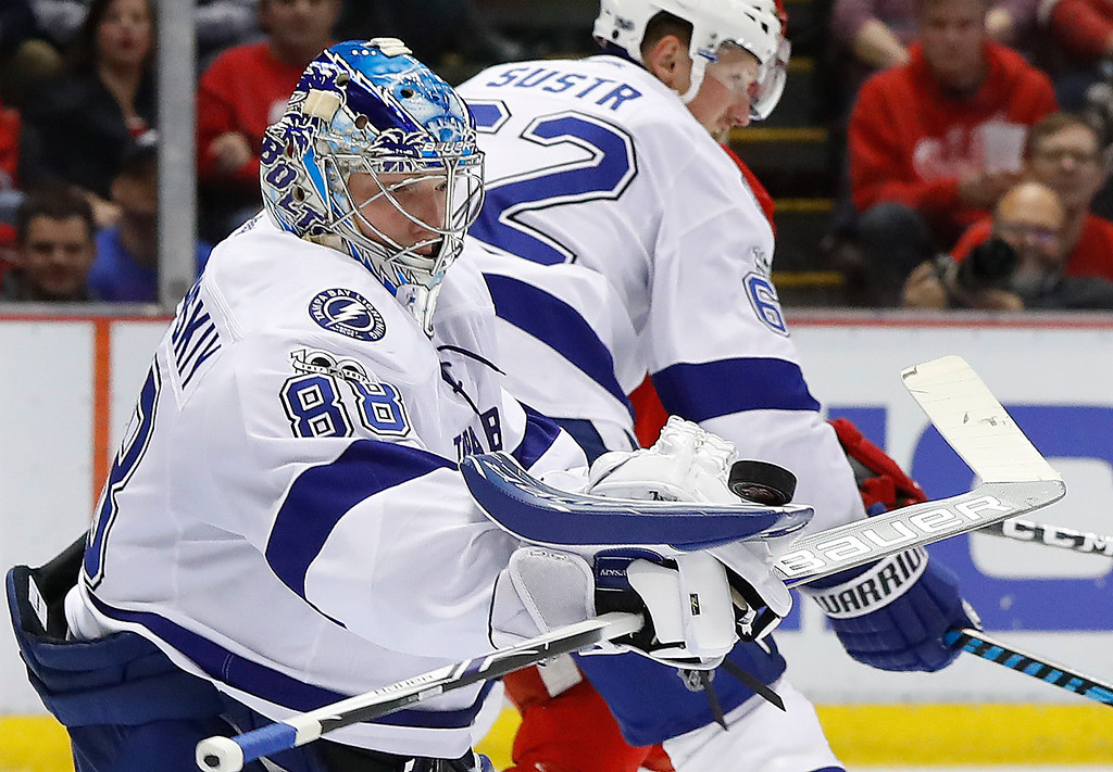 . Tampa Bay Lightning goalie Andrei Vasilevskiy (88) stops the puck with his blocker in the second period of an NHL hockey game against the Detroit Red Wings, Friday, March 24, 2017, in Detroit. (AP Photo/Paul Sancya)