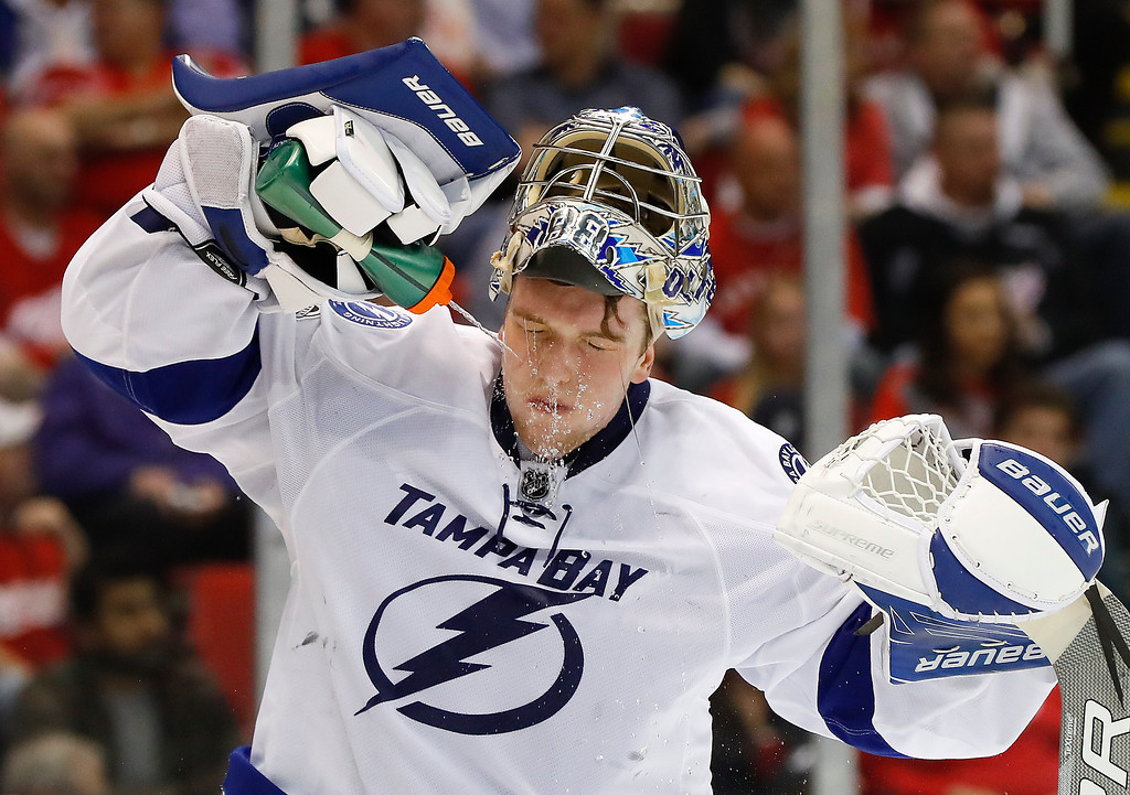 . Tampa Bay Lightning goalie Andrei Vasilevskiy (88) sprays himself with water in the second period of an NHL hockey game against the Detroit Red Wings, Friday, March 24, 2017, in Detroit. (AP Photo/Paul Sancya)