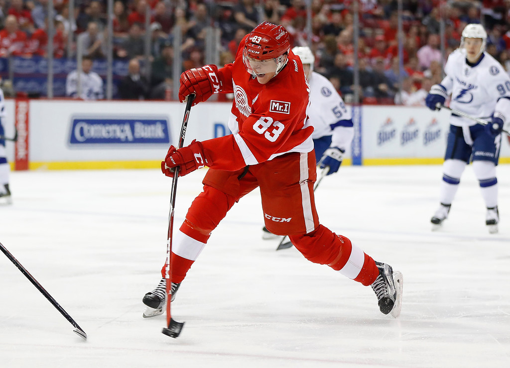 . Detroit Red Wings left wing Tomas Nosek (83) shoots against the Tampa Bay Lightning in the second period of an NHL hockey game Friday, March 24, 2017, in Detroit. (AP Photo/Paul Sancya)