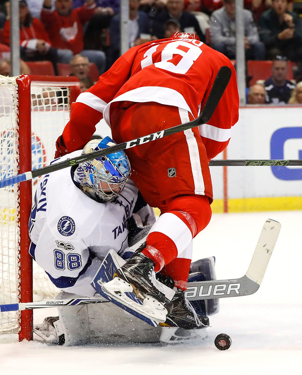 . Tampa Bay Lightning goalie Andrei Vasilevskiy (88) stops a shot by Detroit Red Wings defenseman Robbie Russo (18) in the second period of an NHL hockey game Friday, March 24, 2017, in Detroit. (AP Photo/Paul Sancya)