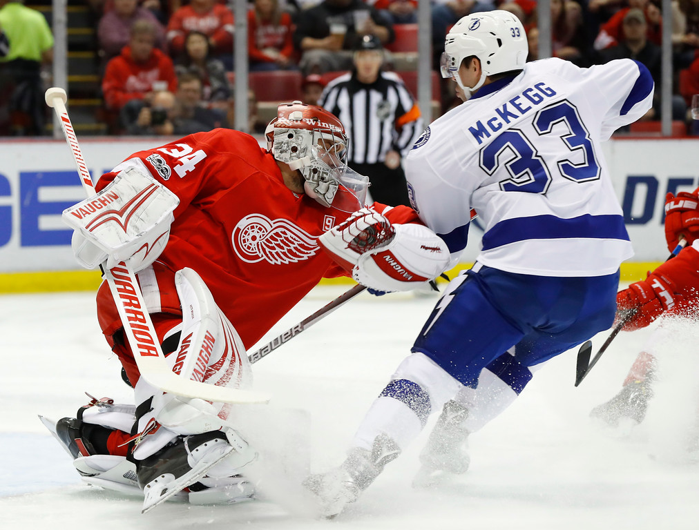 . Detroit Red Wings goalie Petr Mrazek (34) stops a Tampa Bay Lightning center Greg McKegg (33) shot in the first period of an NHL hockey game Friday, March 24, 2017, in Detroit. (AP Photo/Paul Sancya)