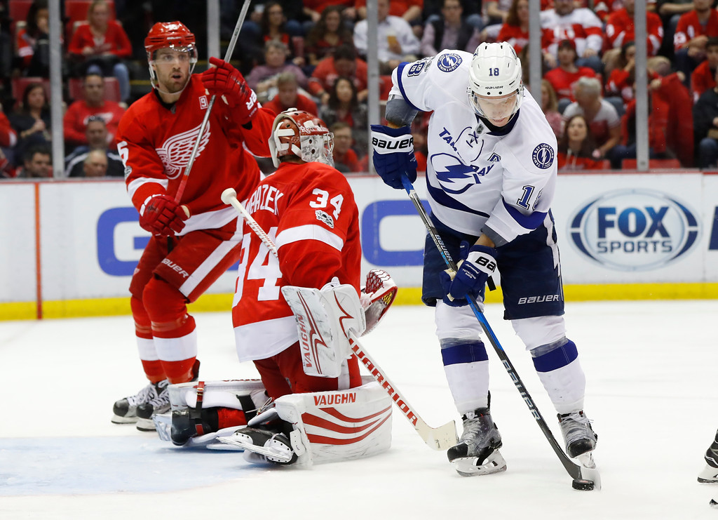 . Tampa Bay Lightning left wing Ondrej Palat (18) shoots to score on Detroit Red Wings goalie Petr Mrazek (34) in the third period of an NHL hockey game Friday, March 24, 2017, in Detroit. (AP Photo/Paul Sancya)