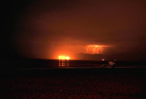 """Malibu Lightning Glow"". View of thunderbolts striking the Santa Monica Mts.  (View from Manhattan Beach)."