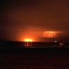 """Malibu Lightning Glow"". View of thunderbolts striking the Santa Monica Mts.  (View from Manhattan Beach)."