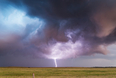 Lightning illuminates an occluded (old and decaying) circulation at dusk near Dexter, KS, on September 1, 2014.