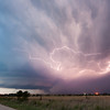 Brilliant lightning flashes throughout the precipitation core of a supercell in the northeast Texas Panhandle at dusk. Viewed from near Shattuck, OK, on June 11, 2011.