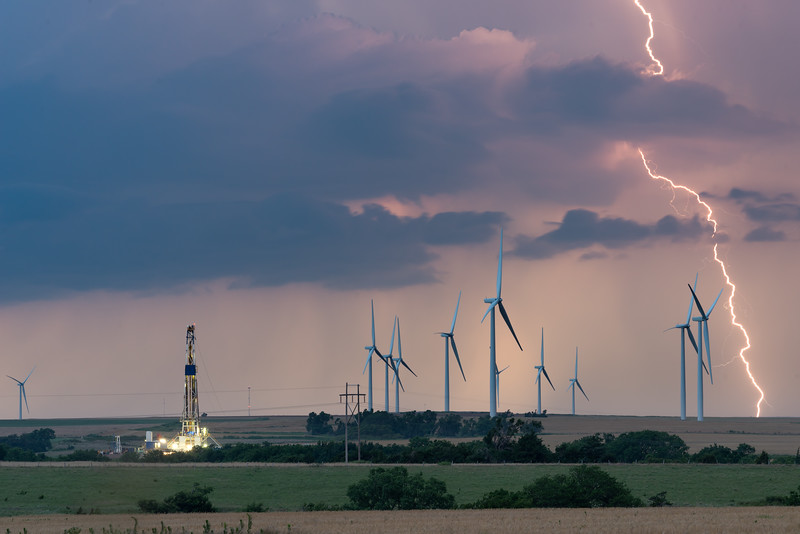 Cloud-to-ground lightning flashes across the Plains behind a wind farm near Seiling, OK, on June 13, 2017.