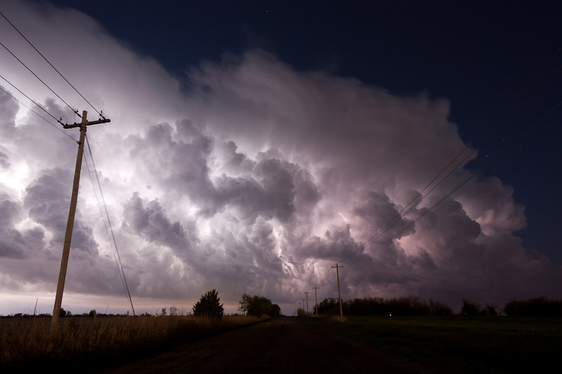 Weak thunderstorms along a cold front are illuminated by nearly-continuous lightning near Norman, OK, on April 18, 2009.