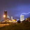 Cloud-to-ground lightning strikes downtown Oklahoma City as a storm approaches on August 12, 2013.