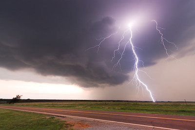 A dangerous cloud-to-ground lightning bolt strikes a field just across the road from the photographer near Cashion, OK, on May 30, 2010.