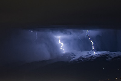 Lightning hitting snow