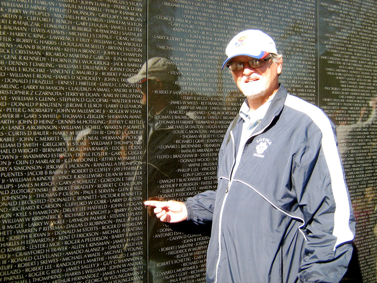 On a teach-in field trip to Washington, D.C. in 2011,  he led a tour of sites to see. Here he poses at the Vietnam Veterans War Memorial and points out the name of a friend who died in the war.  We remember you, Lt. John Hogan.