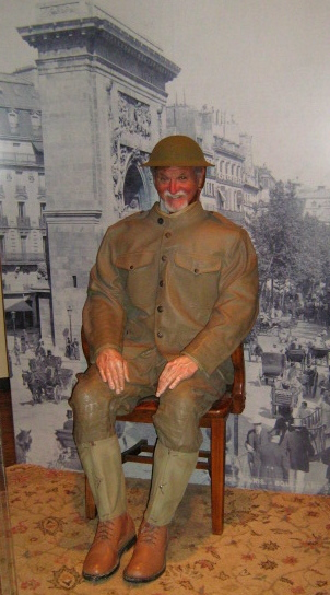 When he discussed WWI and the doughboys, Mr. McClave pulled out this photo taken at the museum in Raleigh, NC, that shows him as a Yank in Paris.