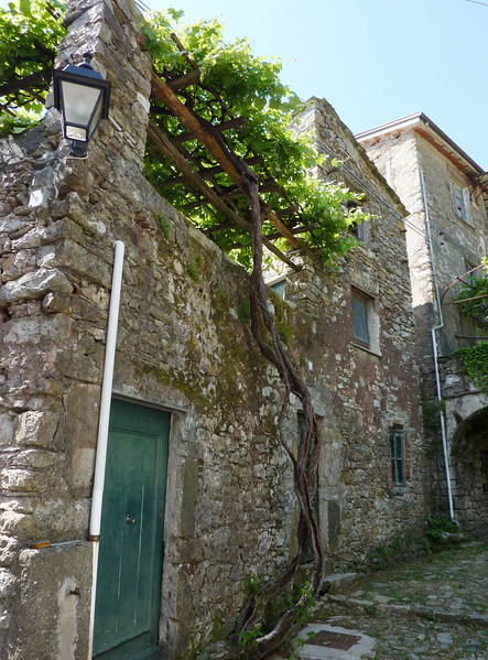 Ancient stone house in the Italian village of Cassagna