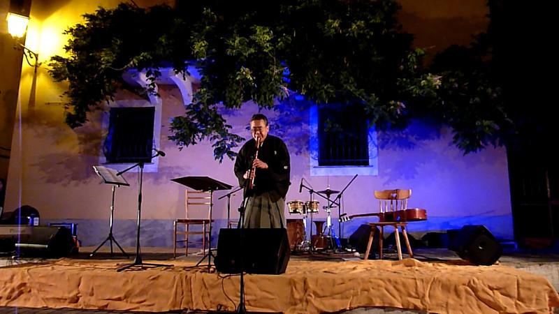 Japanese flautist Hiroshi Konezawa playing in Varese Ligure, Italy, in August 2009.